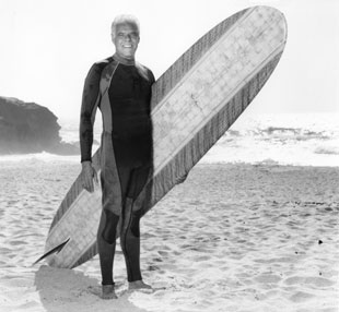 Rob Caughlan with his surfboard